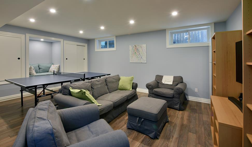 Basement living space with built in seating
